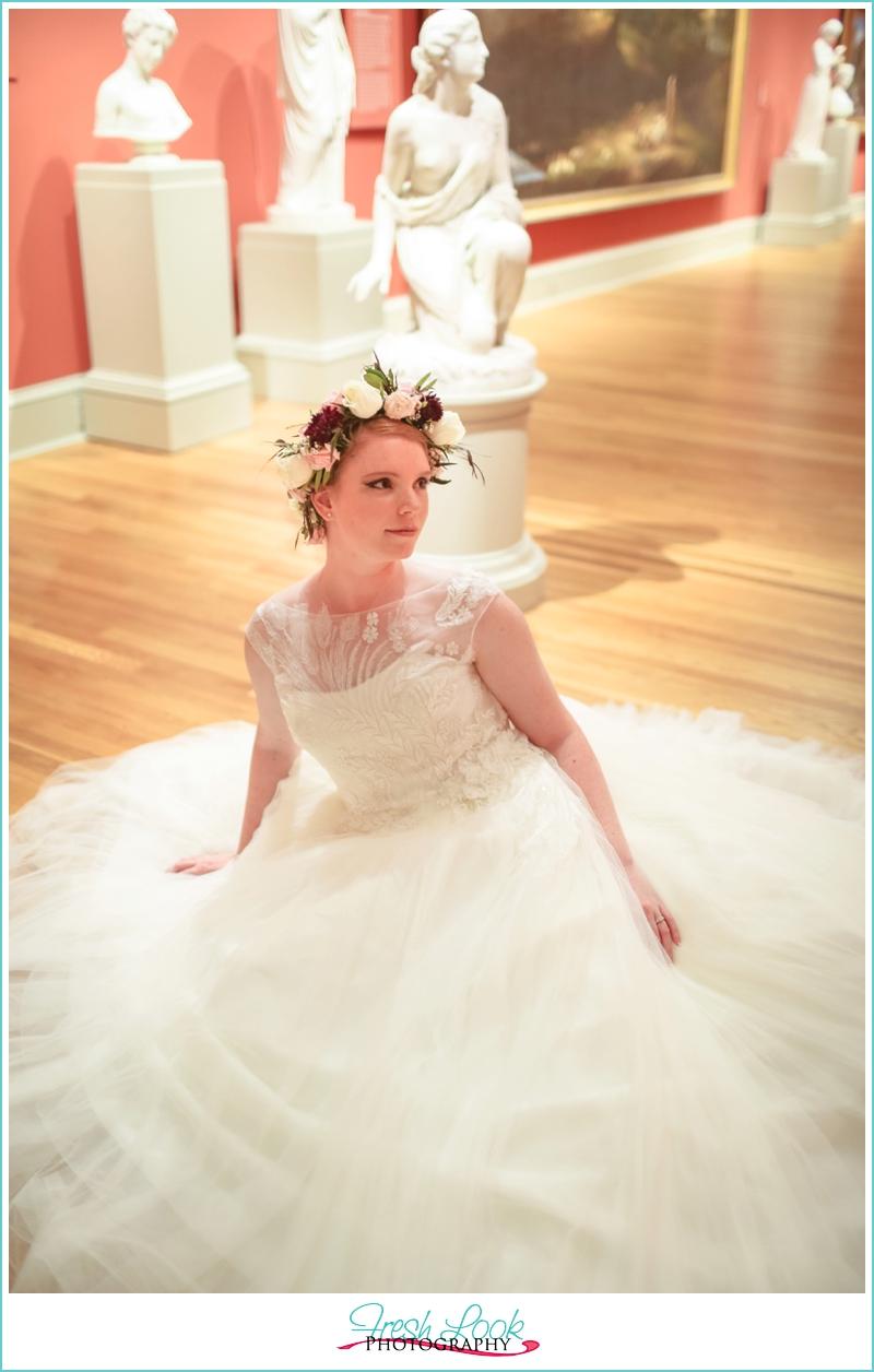 bride amid statues
