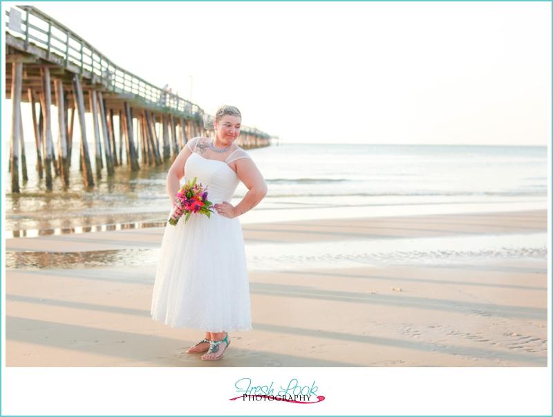 bride having fun on the beach