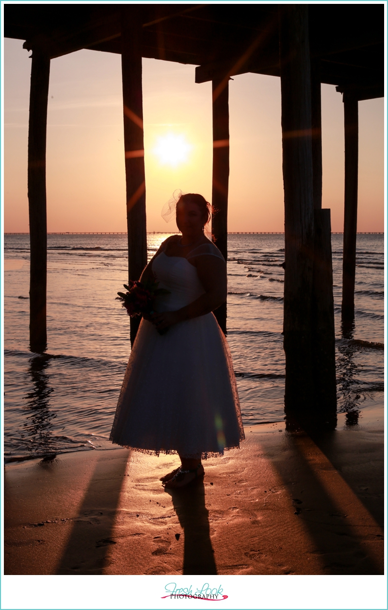 bride on the beach at sunset