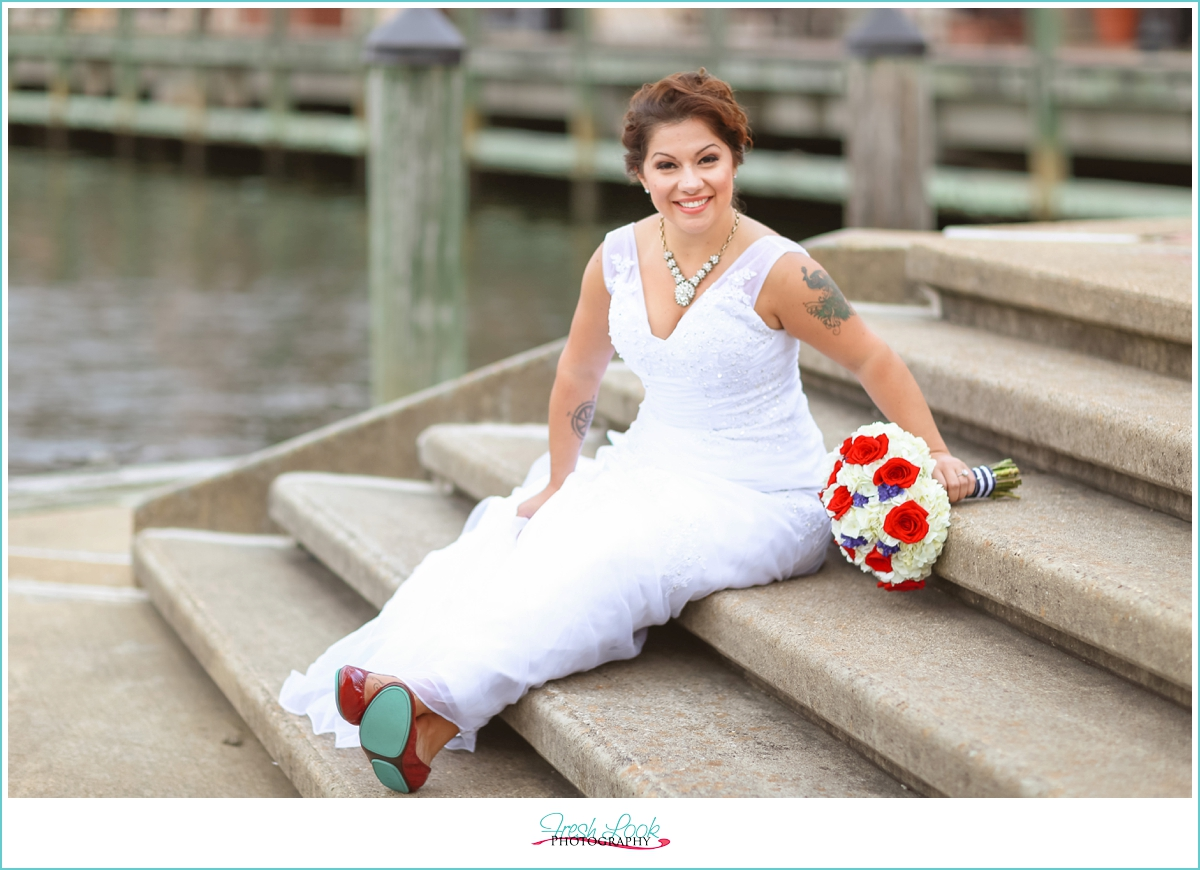 bride sitting on the dock