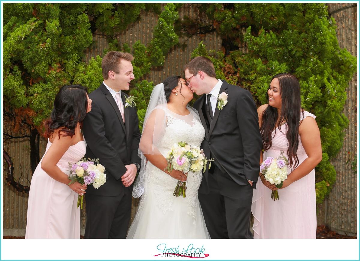 bridal party kissing photo