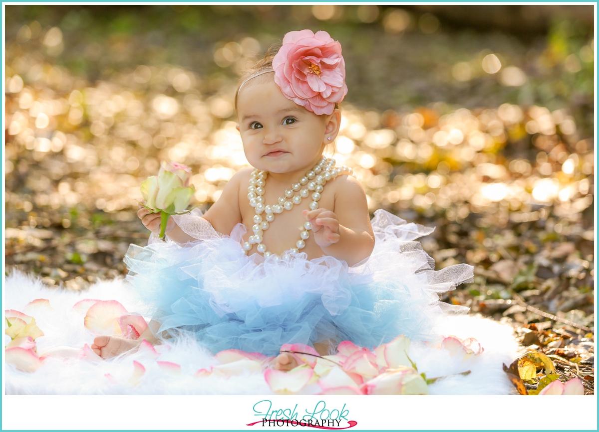 little girl wearing pearls