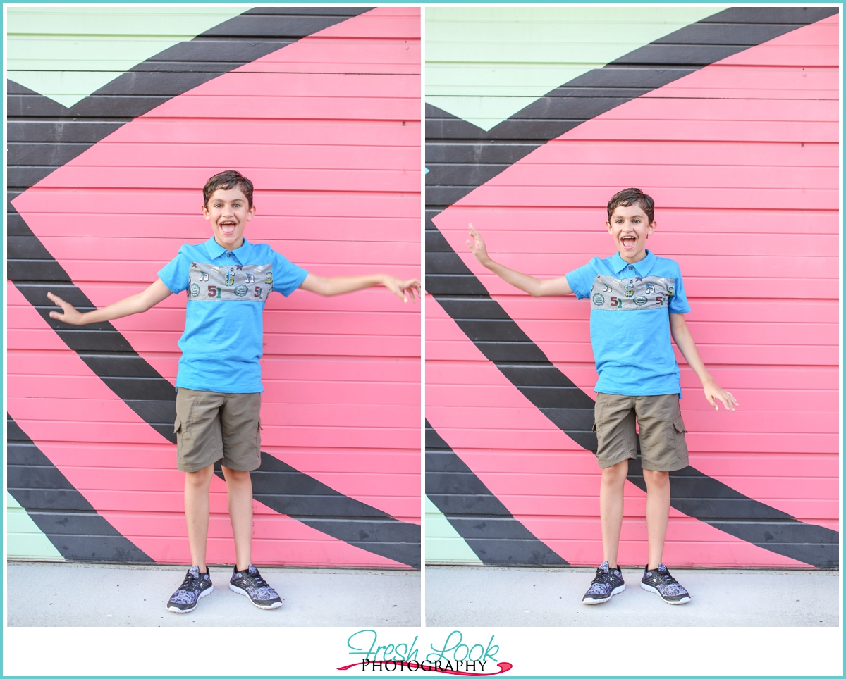 little boy doing the wave during pictures