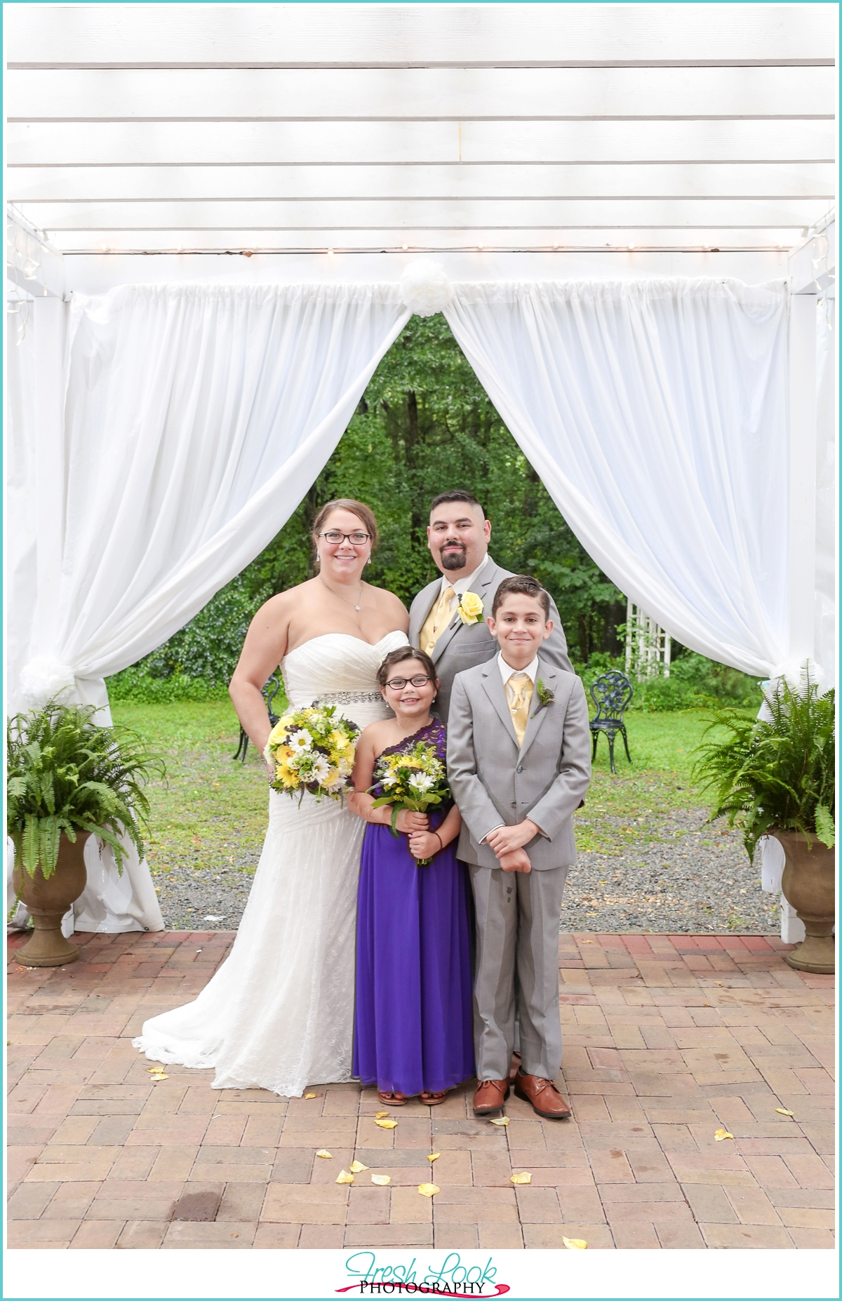 family of four wedding photo