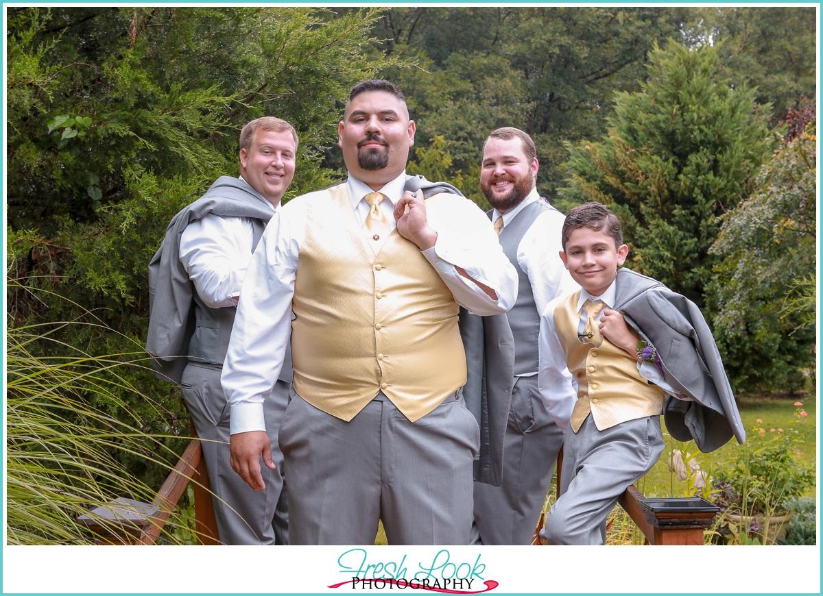 classy groomsmen posing outdoors
