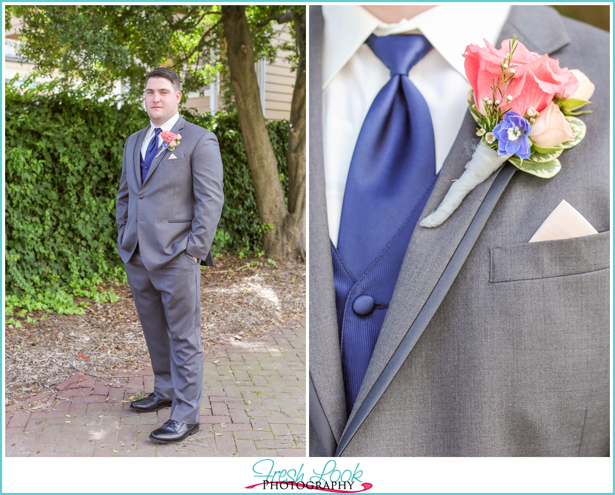 groom wearing gray suit and blue vest