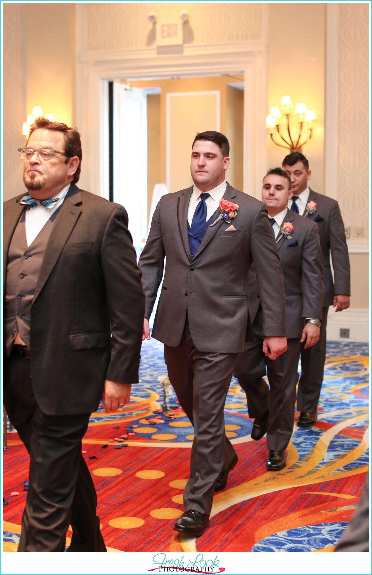 groom walking into the wedding