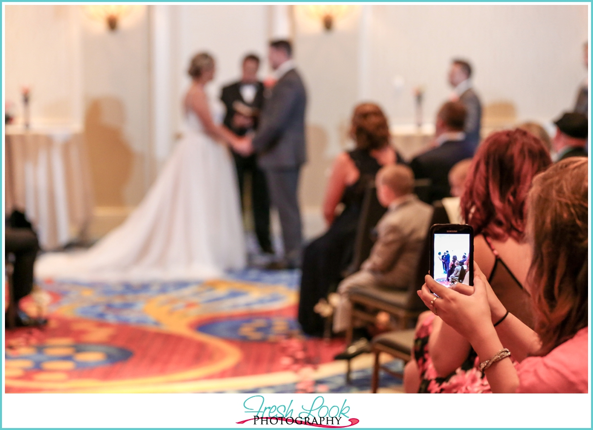snapping a picture of the wedding