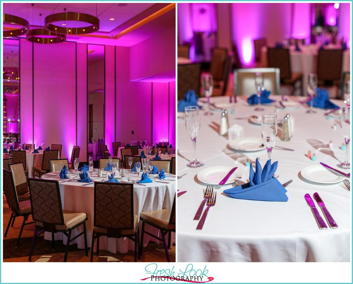 wedding reception with pink lighting