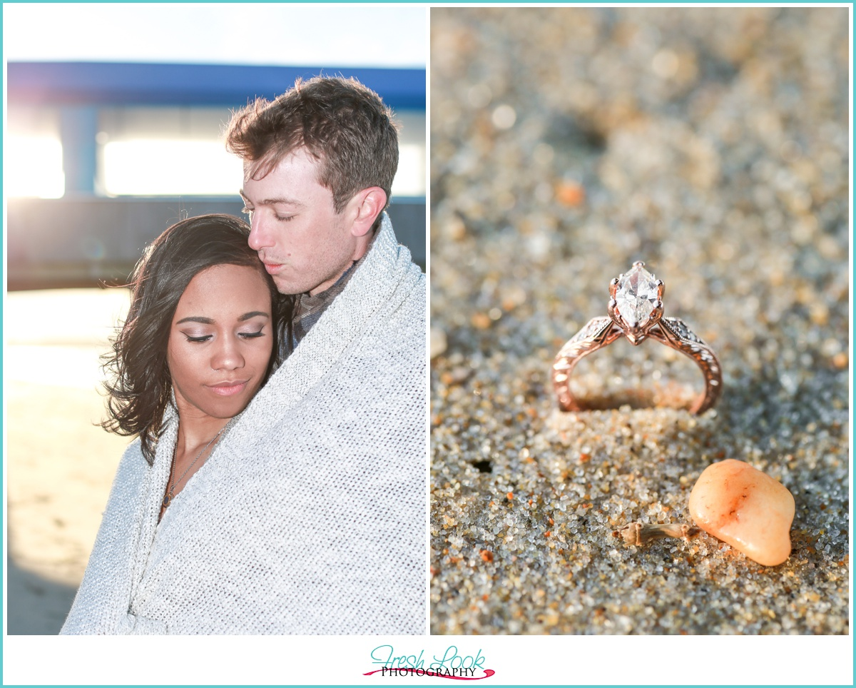 snuggling together beach engagement ring