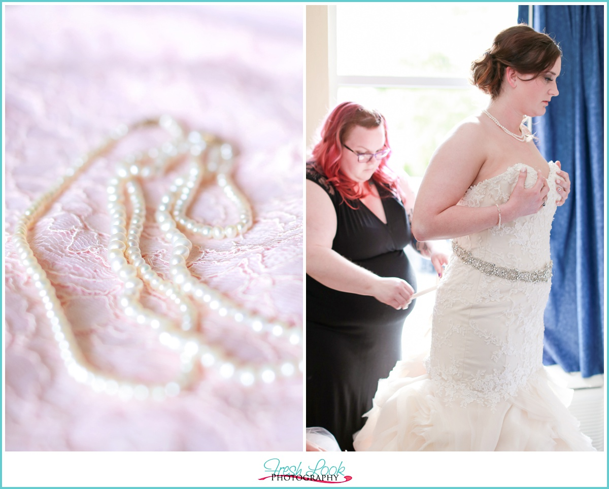 lacing up the wedding gown