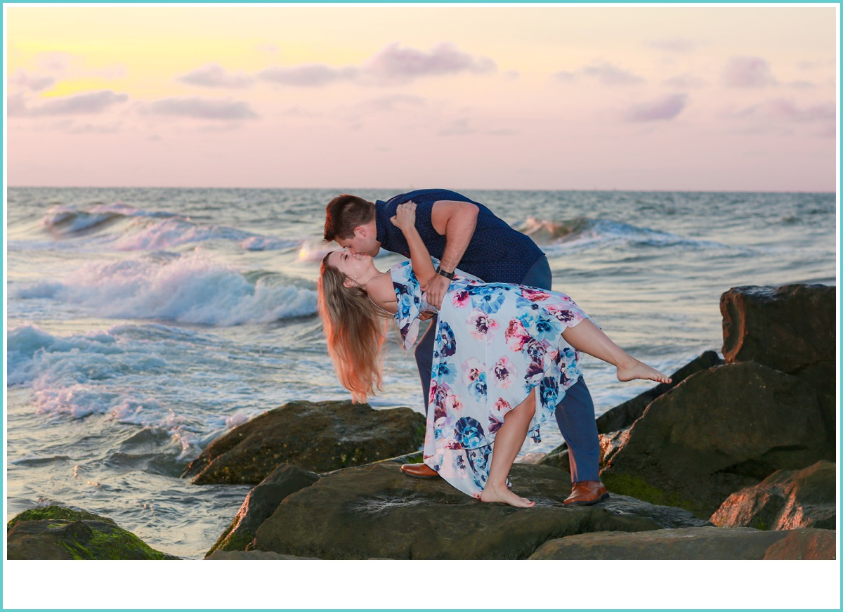 romantic dip and kiss by the sea