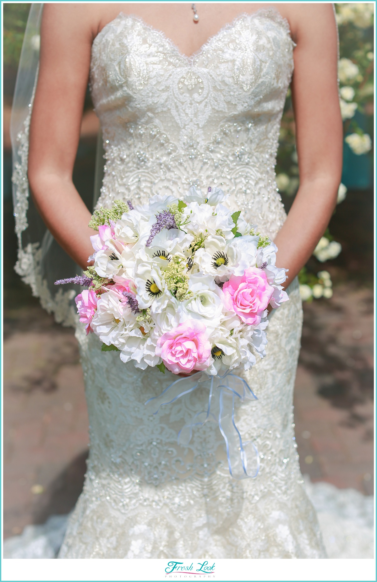 bridal bouquet and lace dress