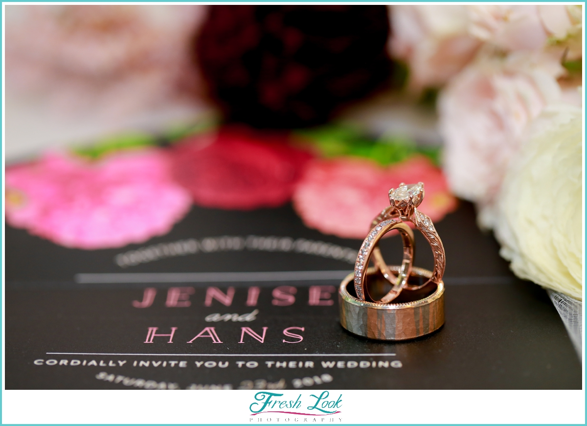 Rose gold wedding rings and stationery
