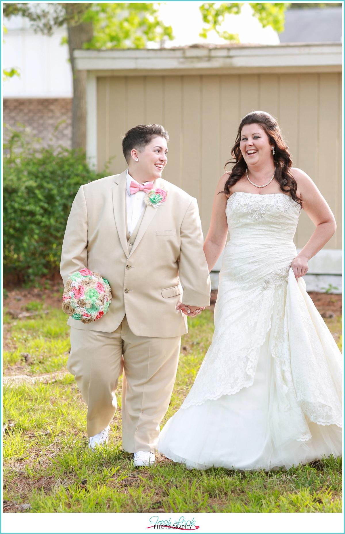 LGBT brides laughing together