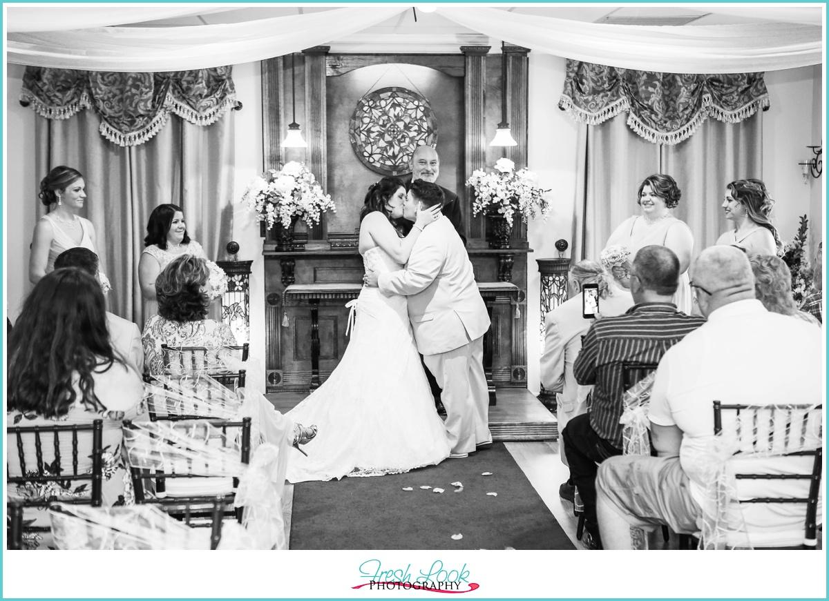 wedding kisses at the altar