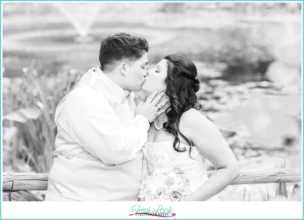black and white kissing photo