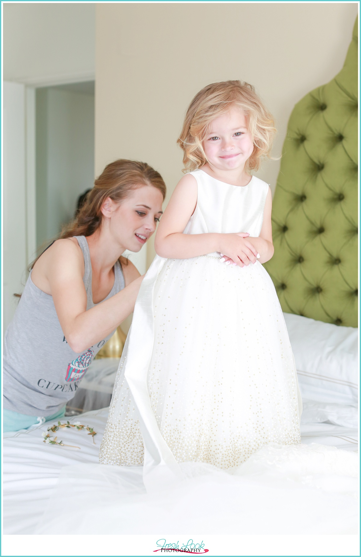 Bride getting flower girl ready