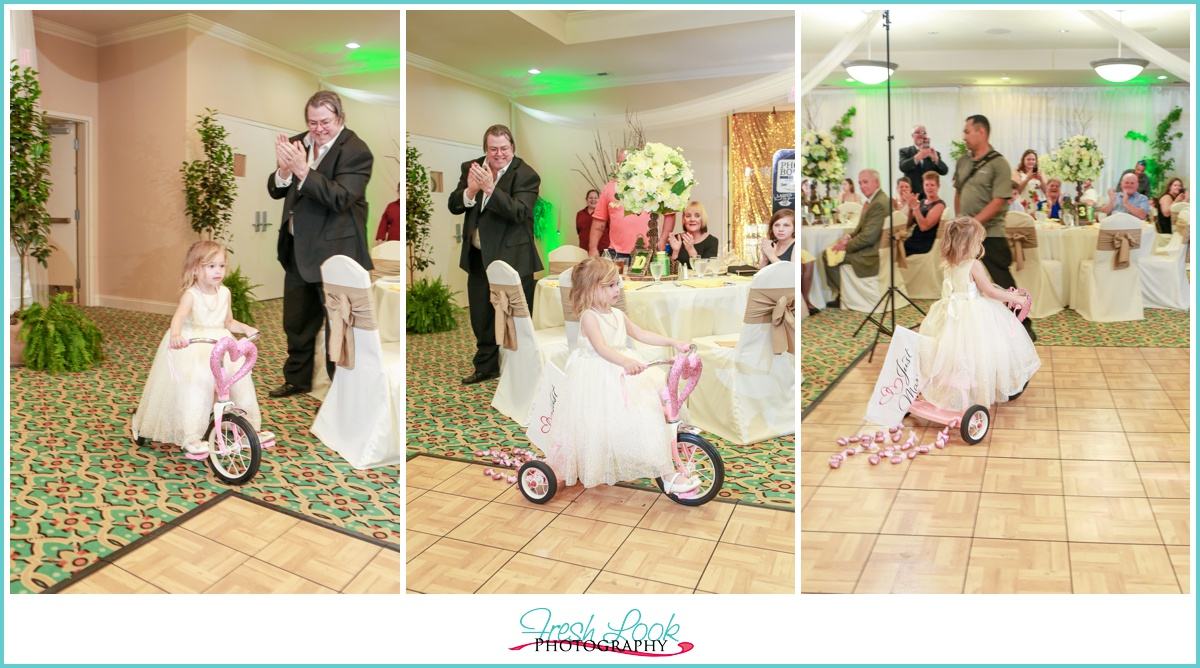flower girl on trike at reception