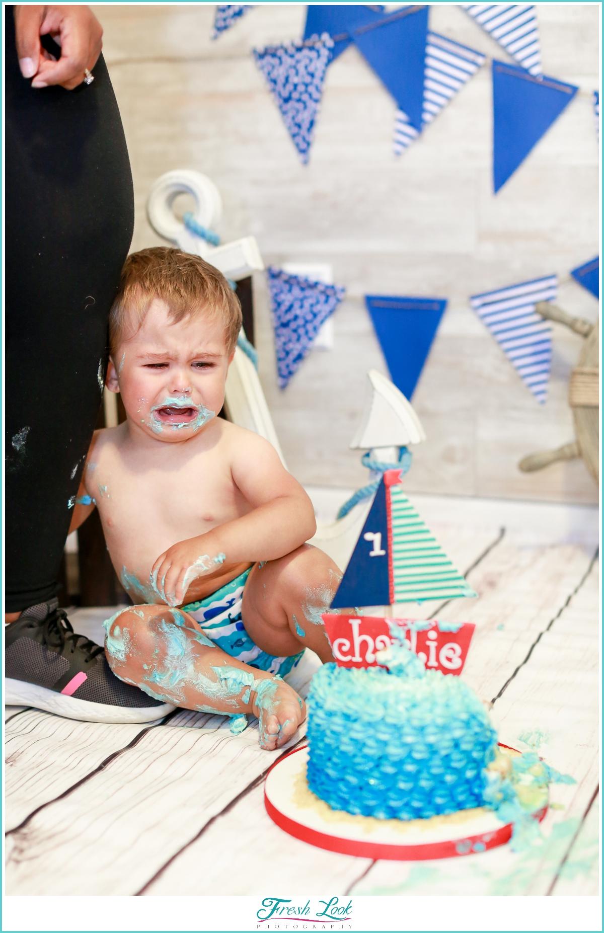 crying baby during cake smash