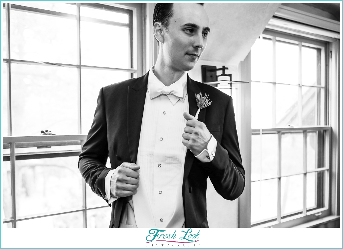 handsome groom in black and white