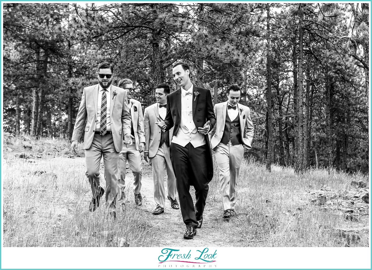groom and groomsmen walking in Colorado