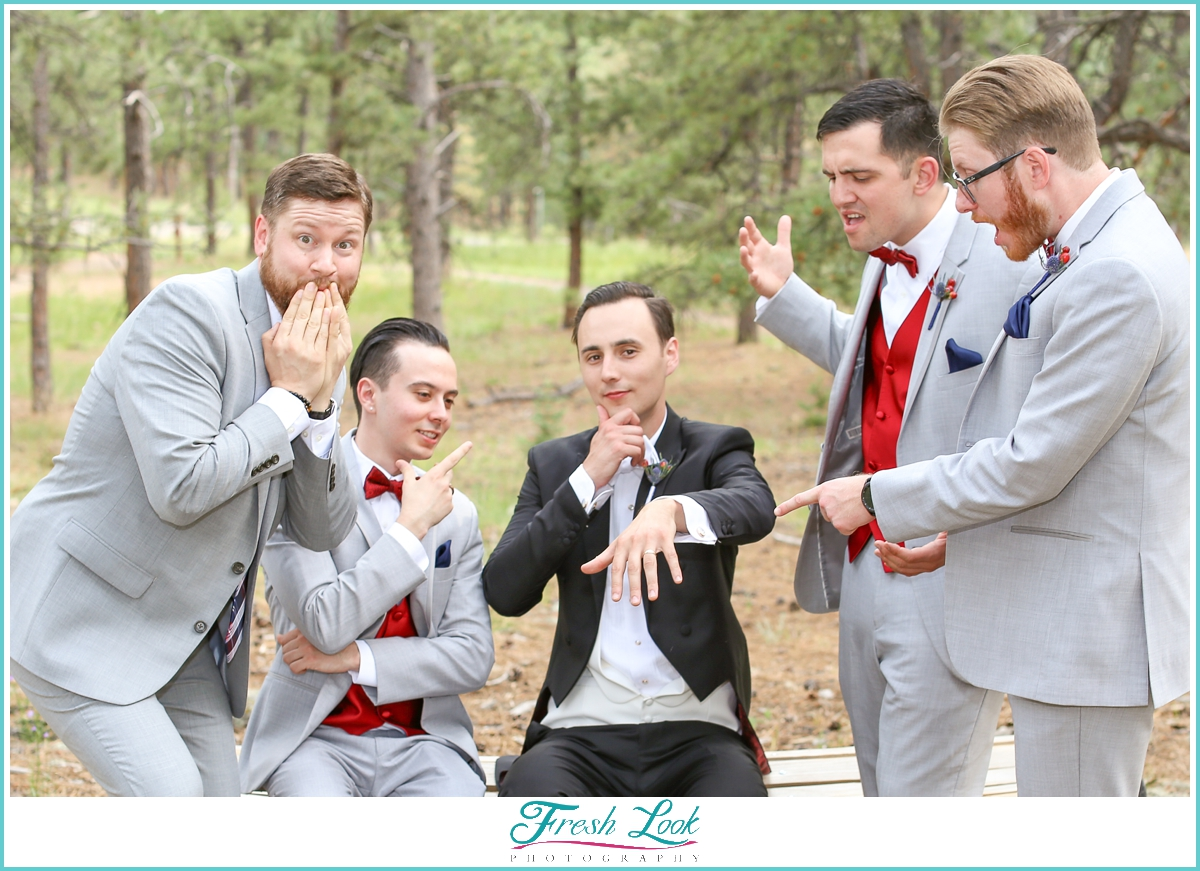 groom and groomsmen being silly