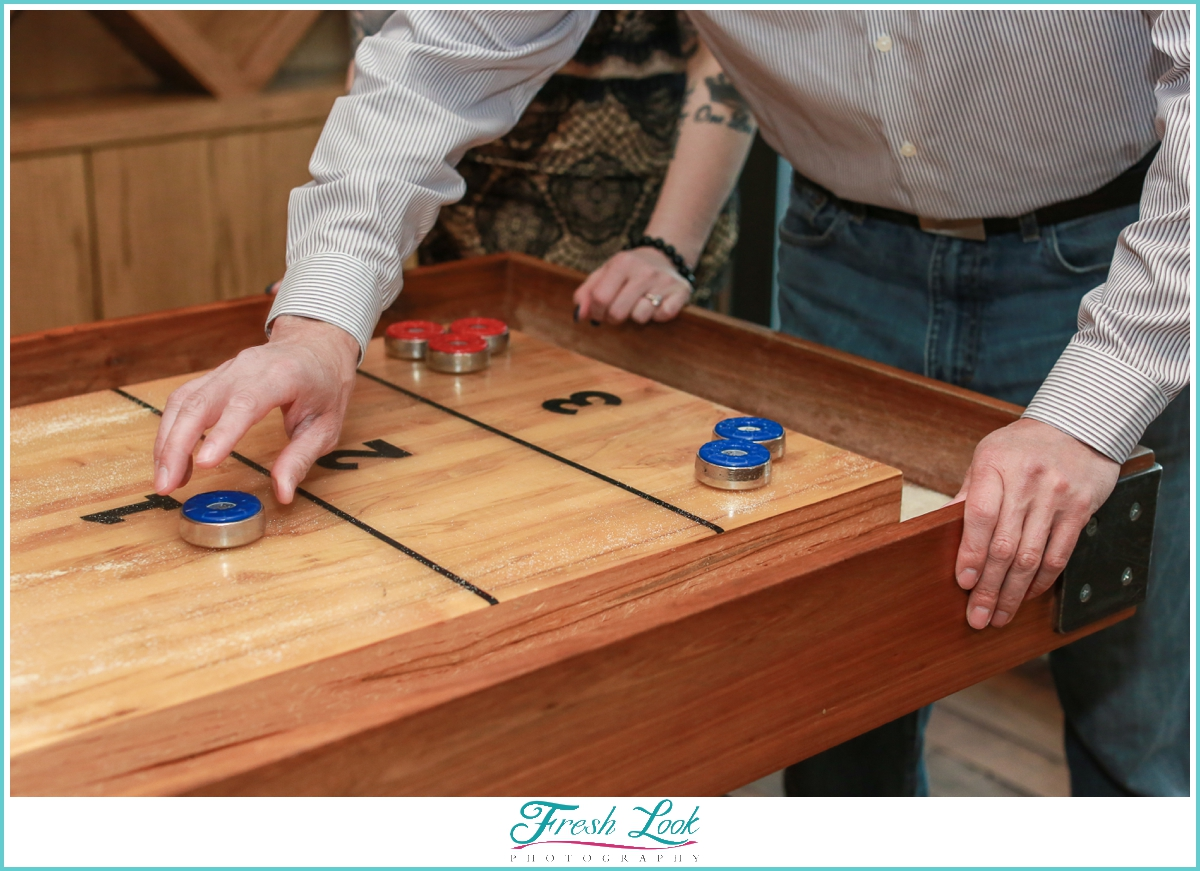 playing shuffleboard together