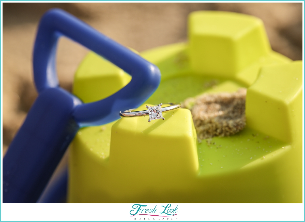 engagement ring ideas on sand and bucket