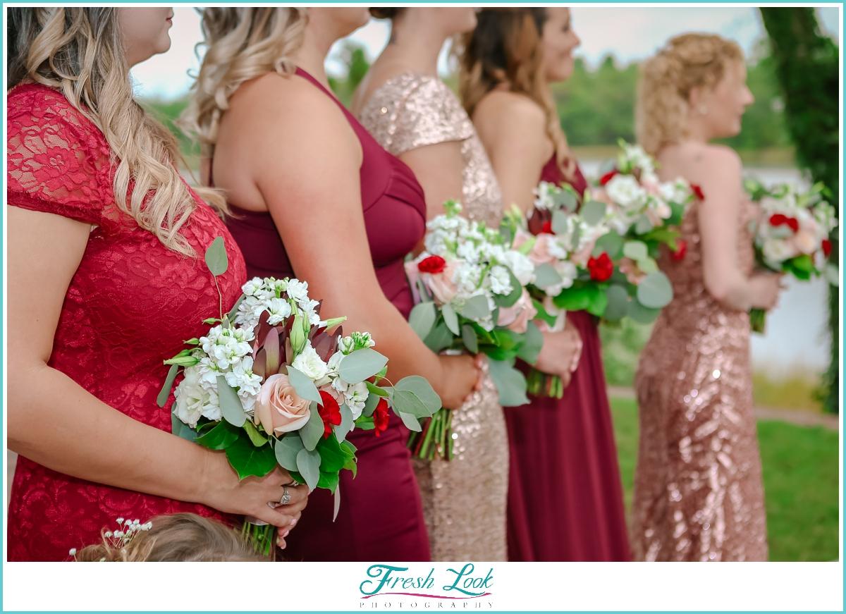 bridesmaids wearing red dresses