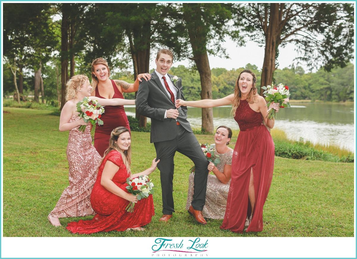 bridesmaids having fun with the groom