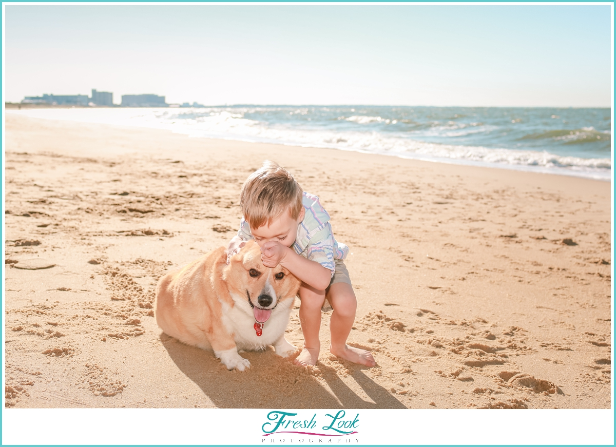 playing with the puppy on the beach