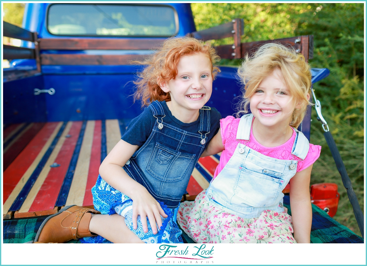 sisters in vintage truck photo shoot
