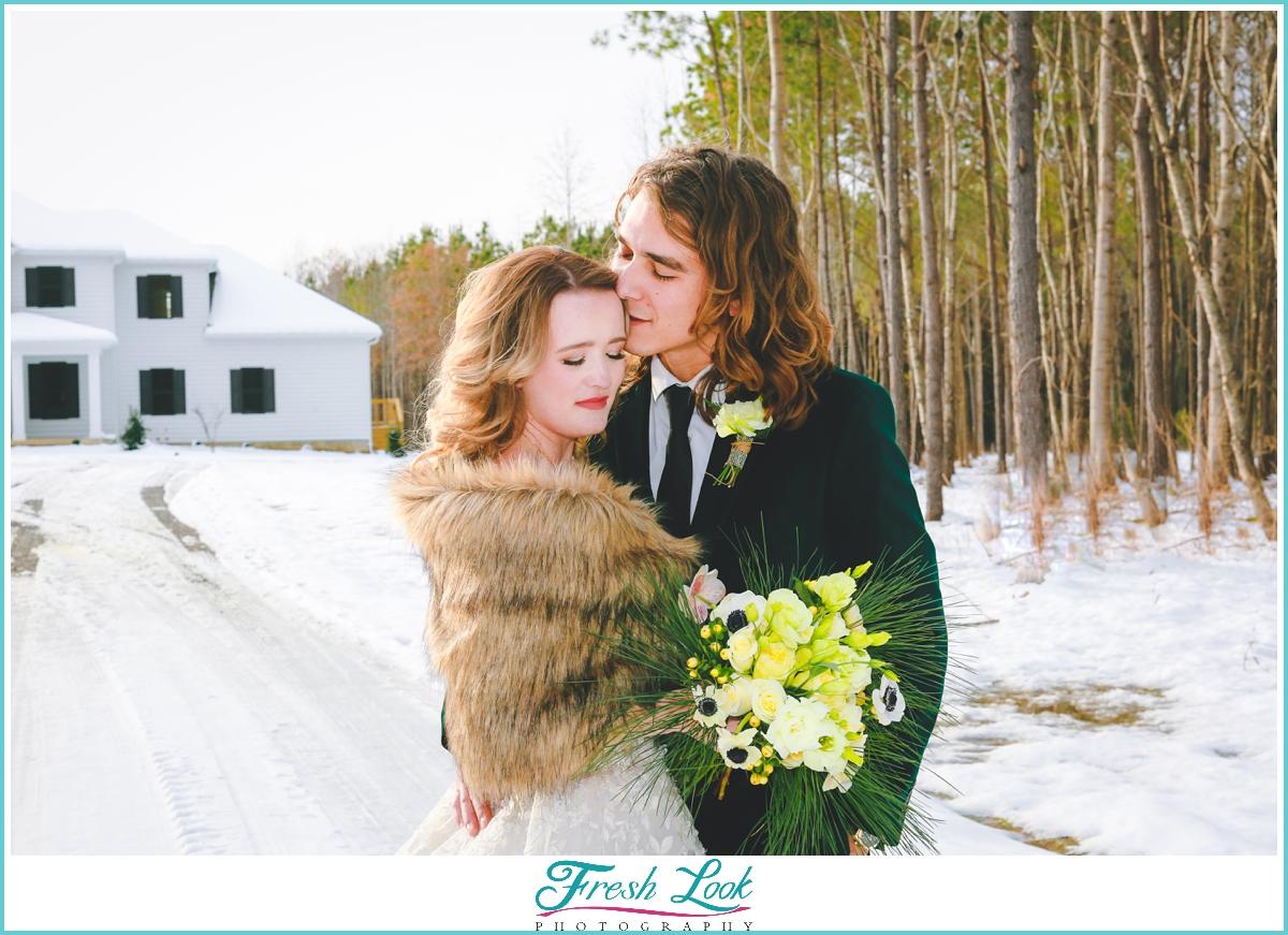 Snowy winter wedding portraits