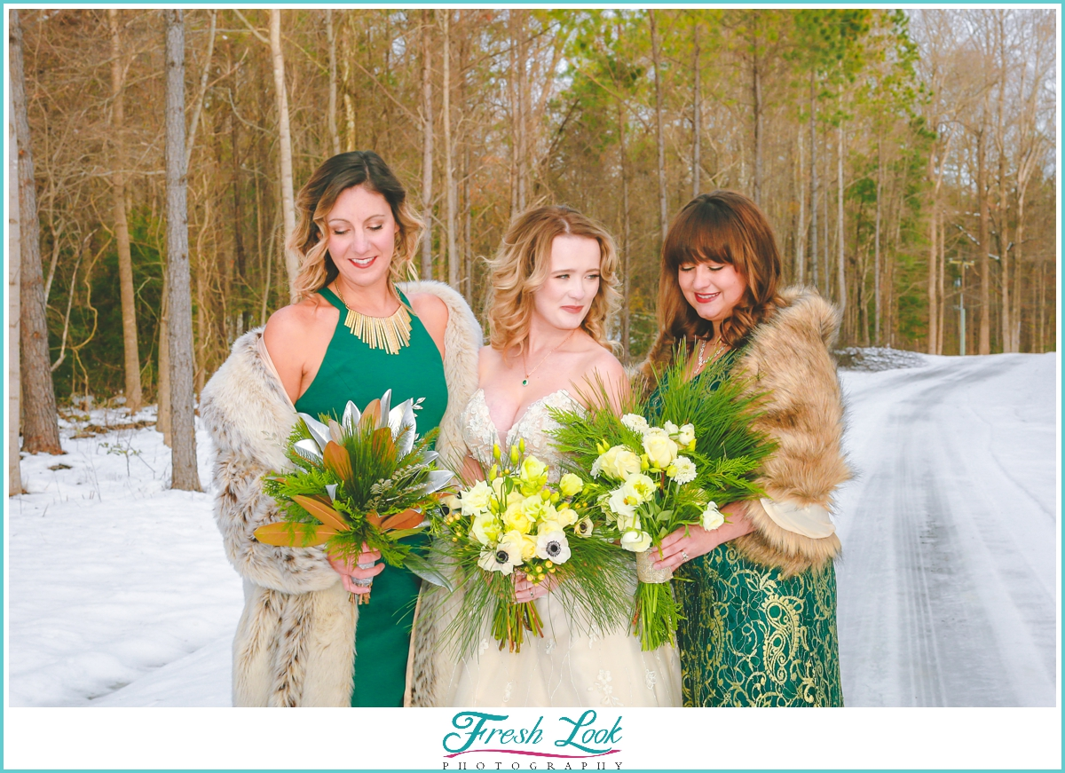 bride and bridesmaids snow portraits