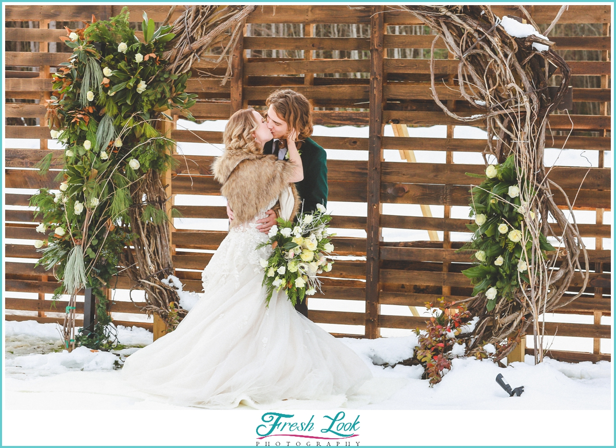Fun bride and groom photos in the snow