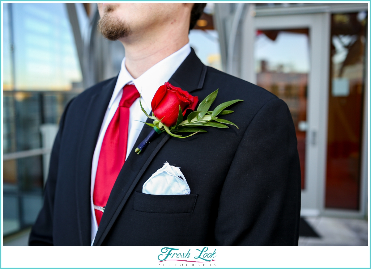 groom with rose boutonniere