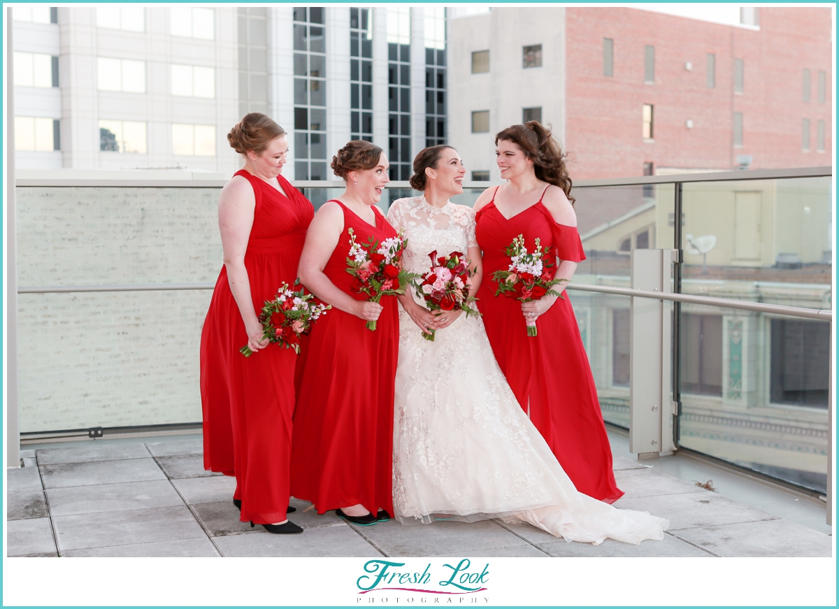 bridesmaids wearing red gowns