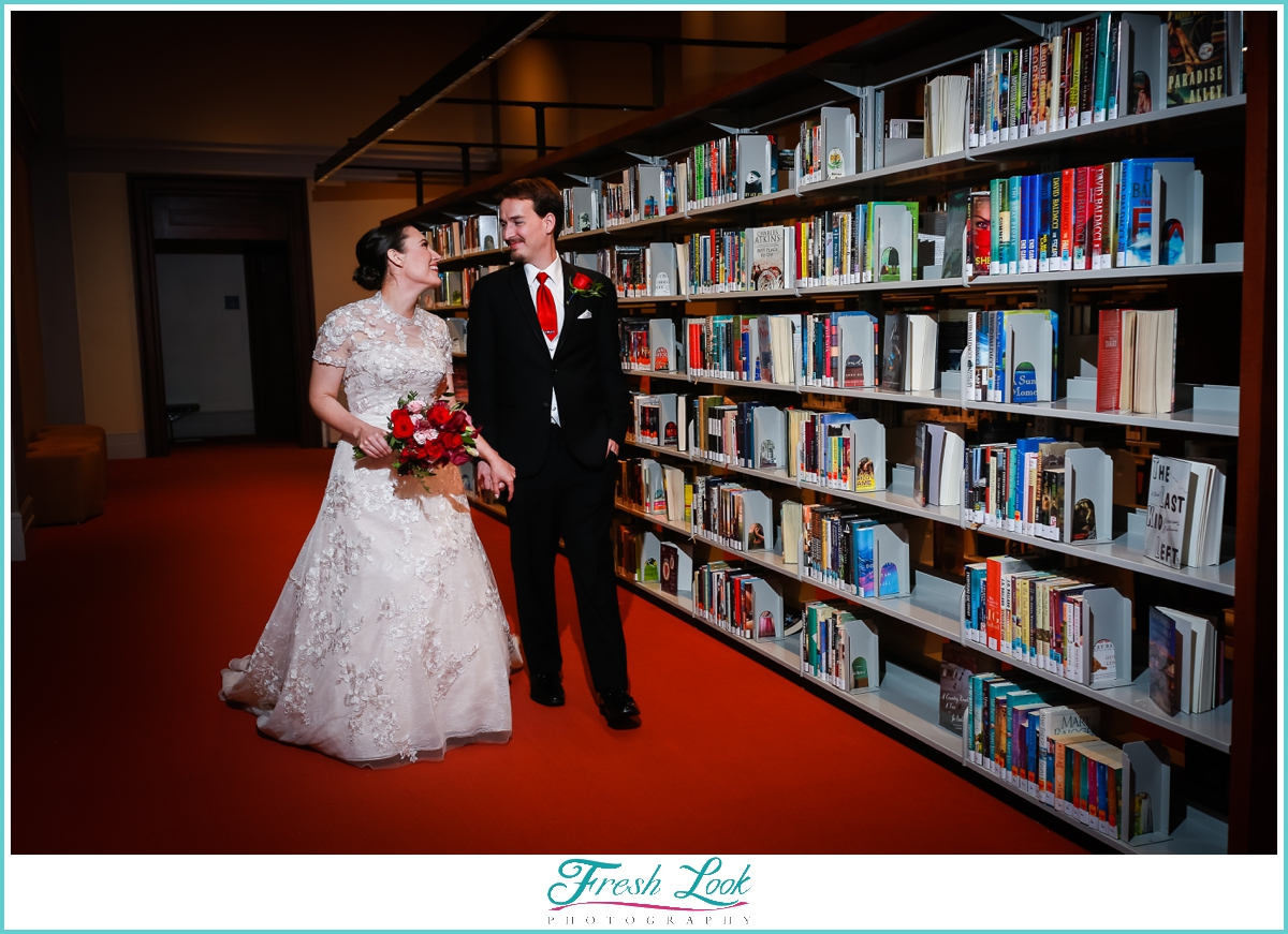 bride and groom walking in the library