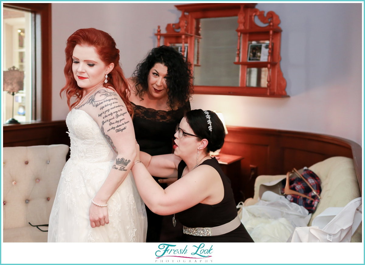 bride getting dressed before the wedding