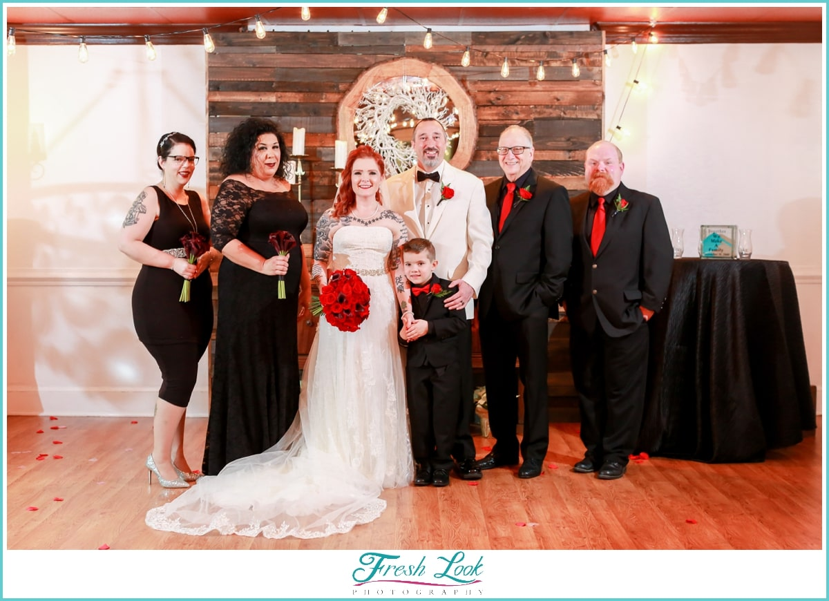 classy bridal party wearing black and red
