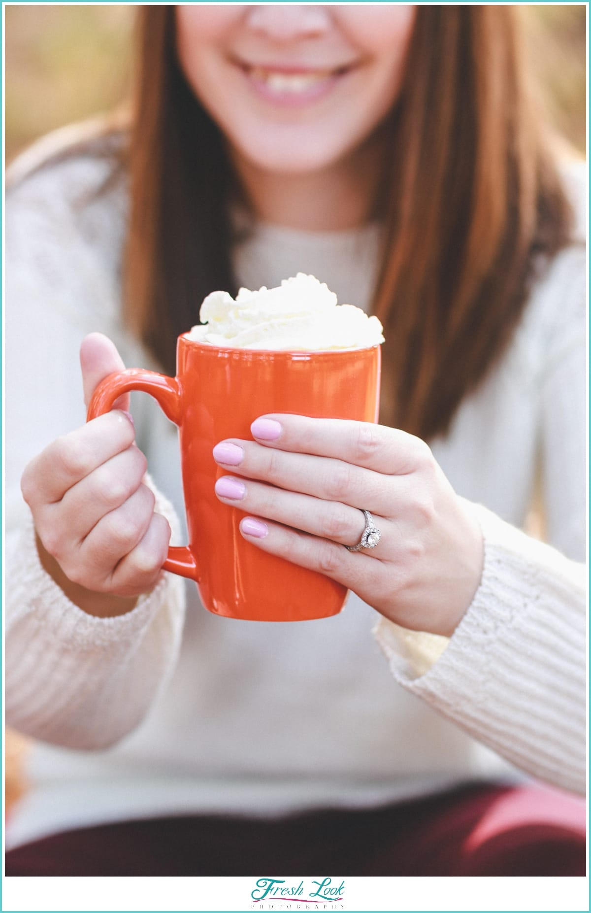 hot cocoa with whip cream at engagement shoot