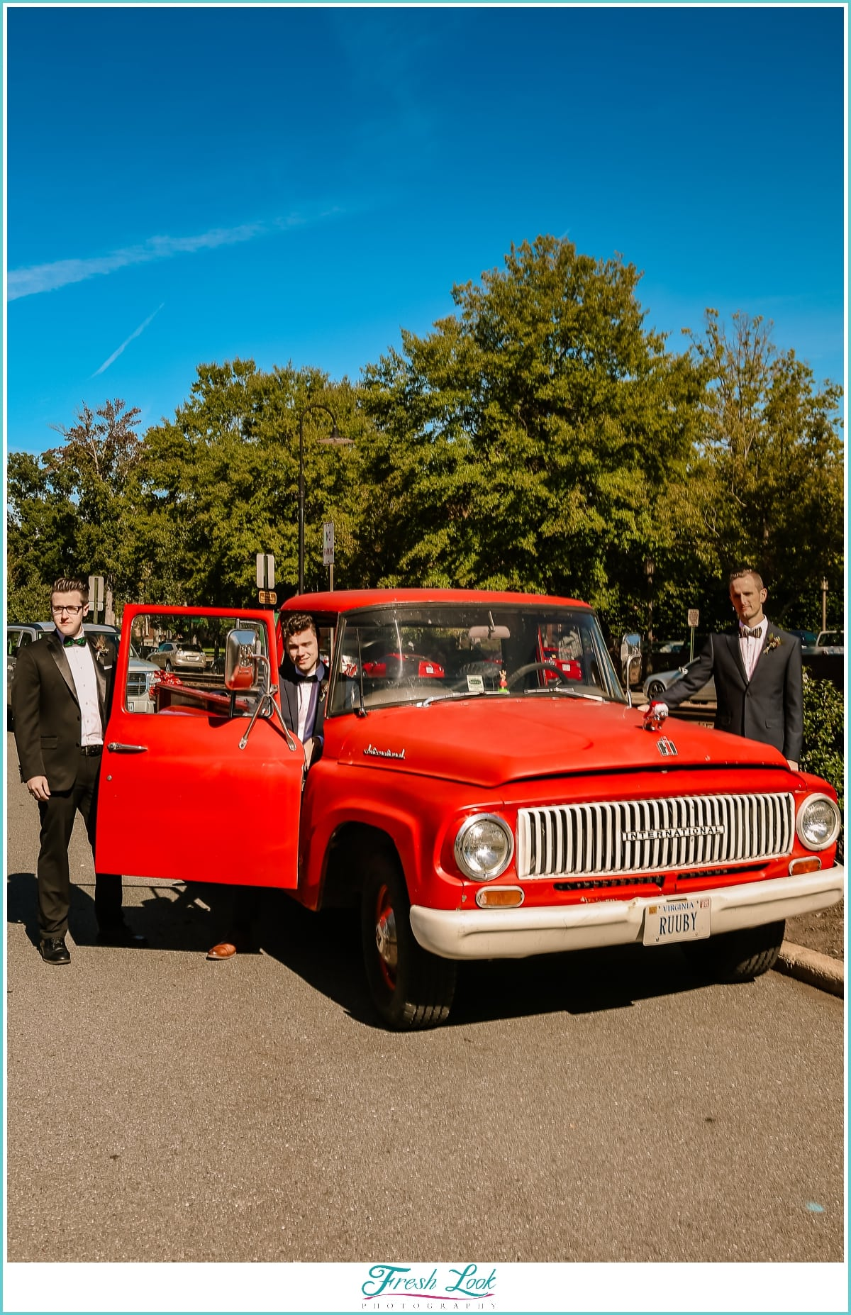 groom and groomsmen with vintage truck