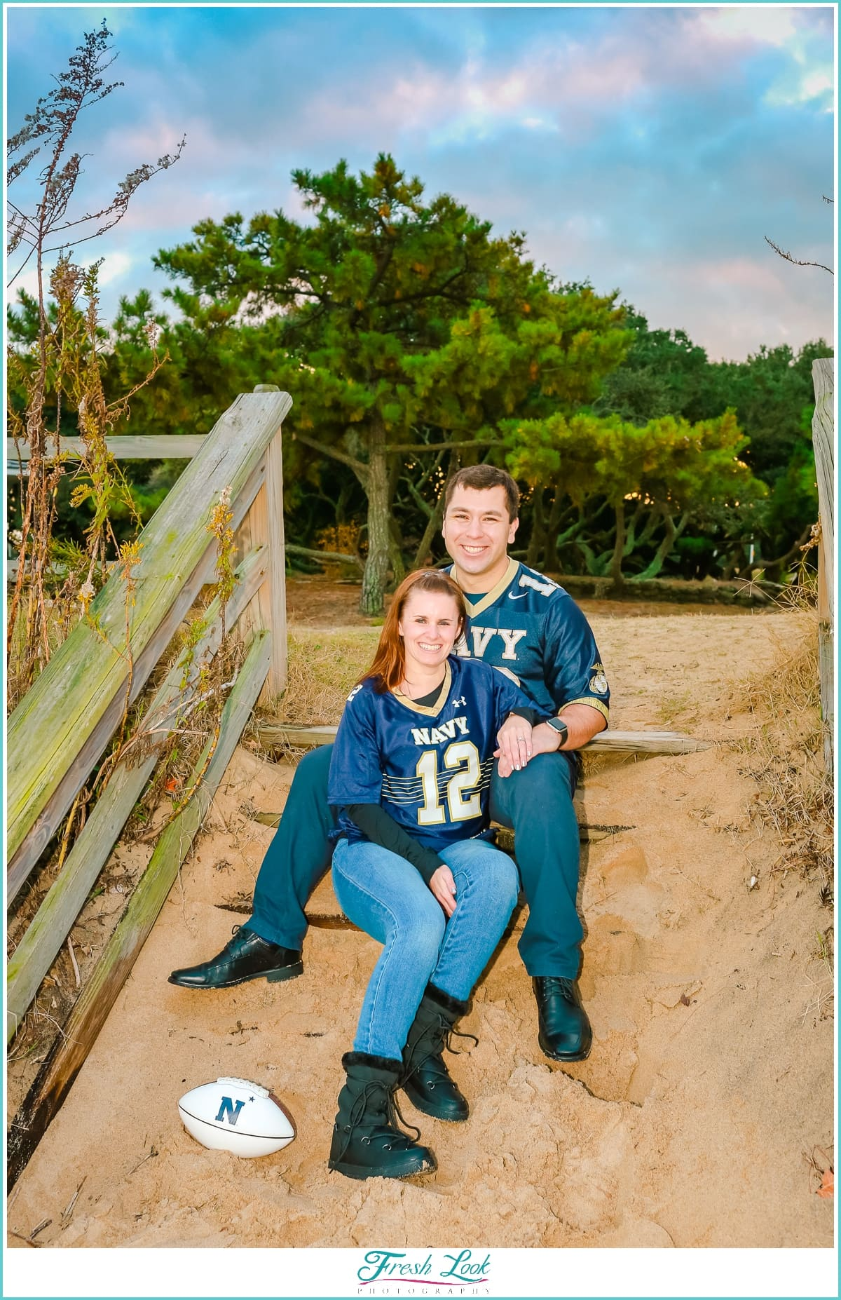 sitting in the sand at the engagement session