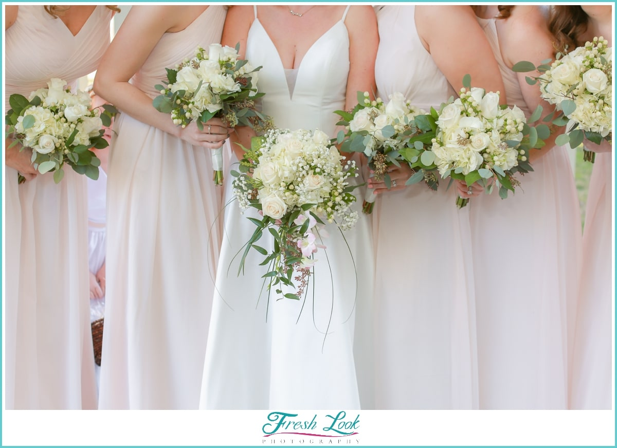 Blush bridesmaid dresses and bouquet