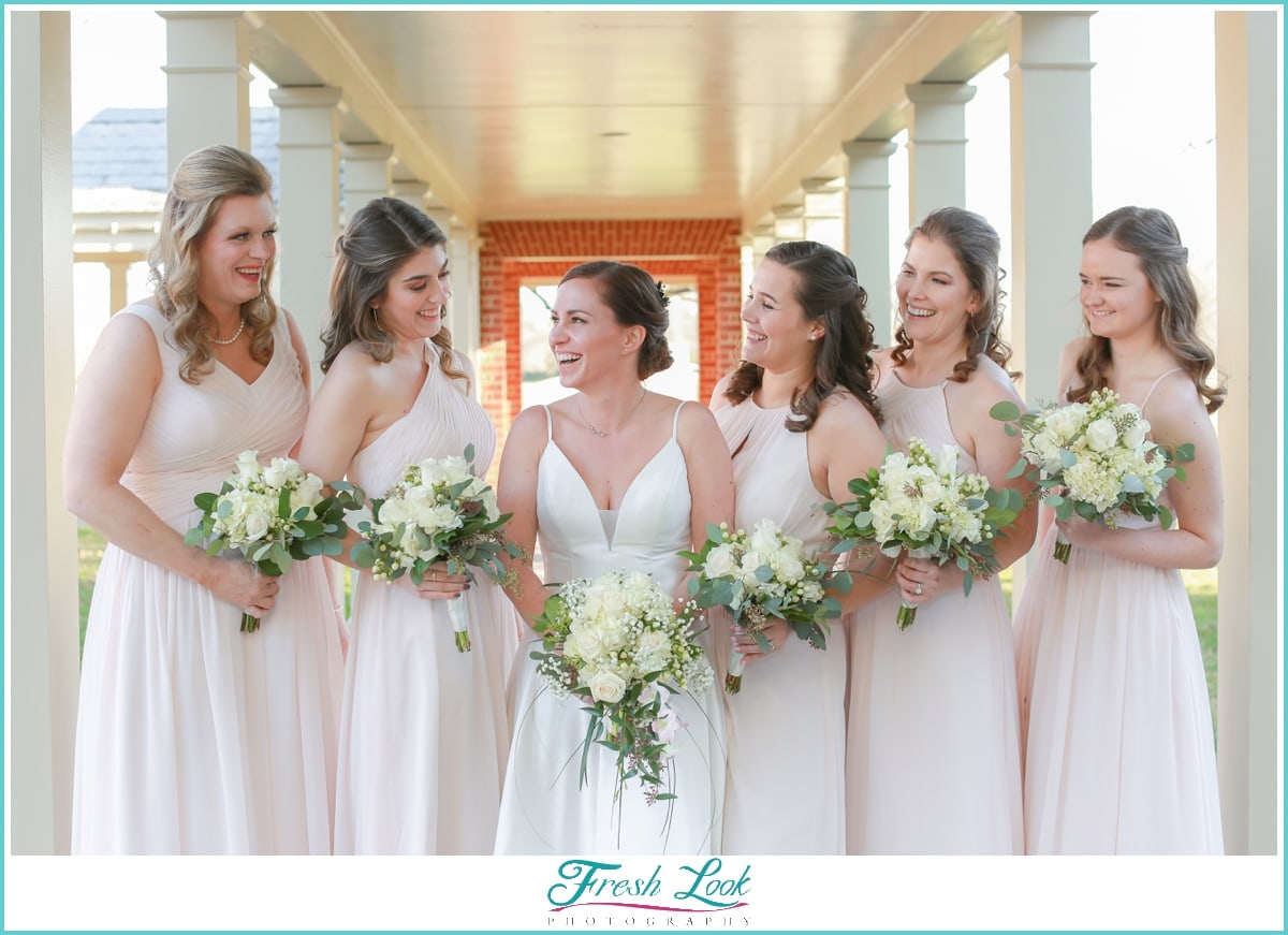 bride and bridesmaids wearing blush