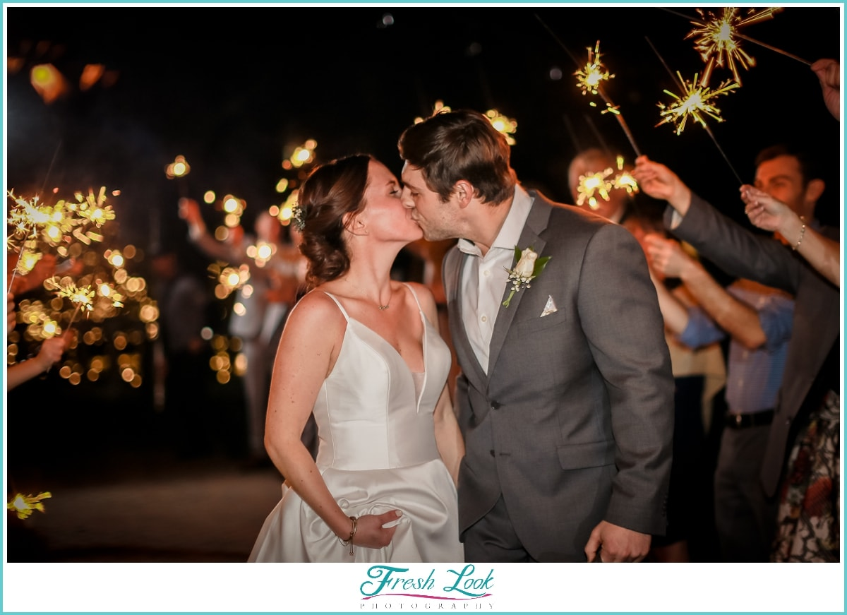 kiss during sparkler exit at Founders Inn