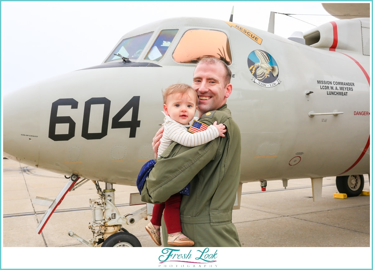 daddy and his baby by the aircraft
