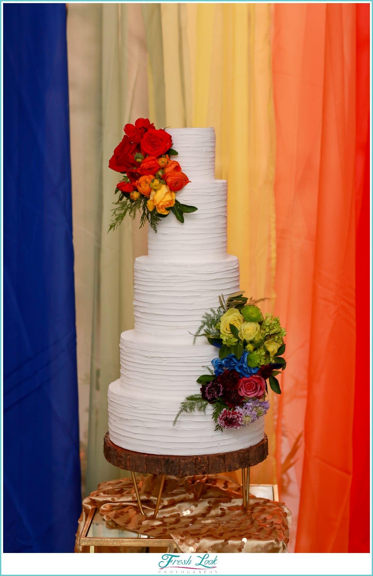 rainbow themed wedding cake