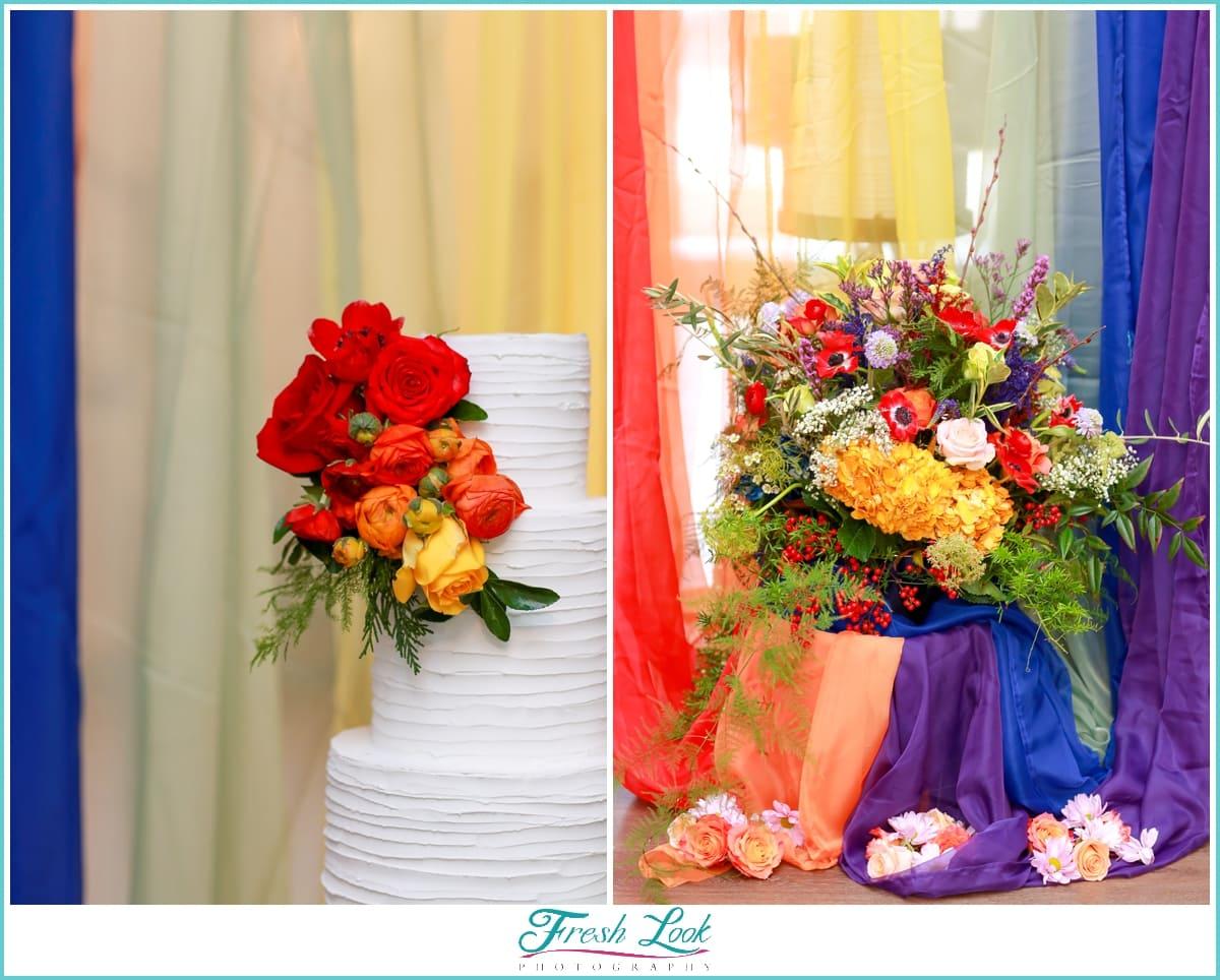 rainbow wedding cake and flowers